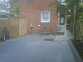 natural stone landscaping work completed in or near little italy toronto - shed assemply and placement as well as staining work also shown